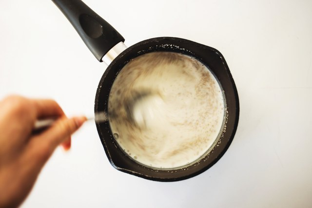 Whisk together the milk and yeast until it is combined.
