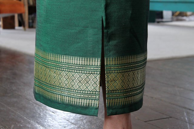 Slit in the side of the skirt.