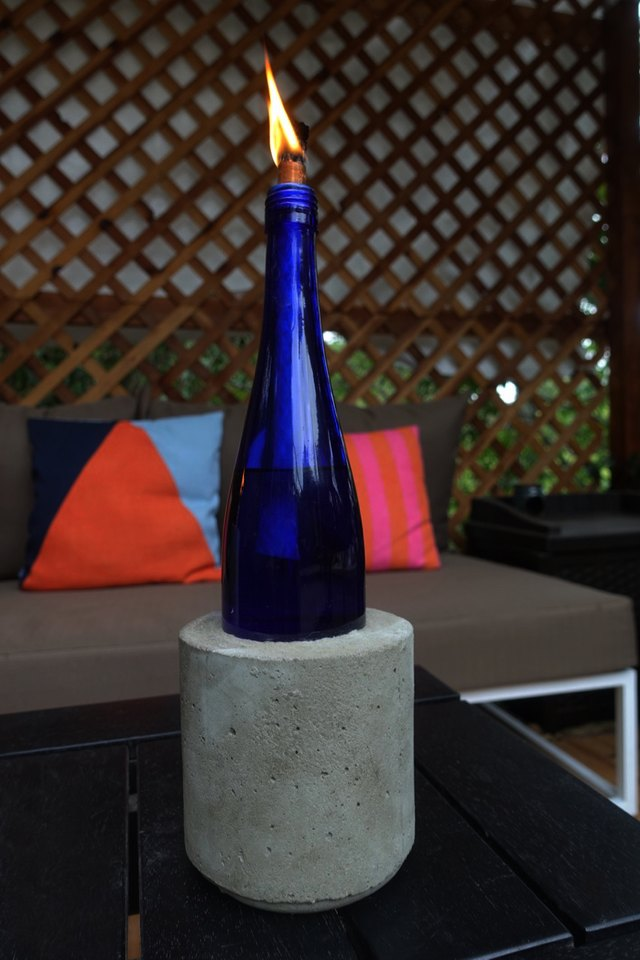 Materials: cobalt blue wine bottle and cylindrical plastic food container.