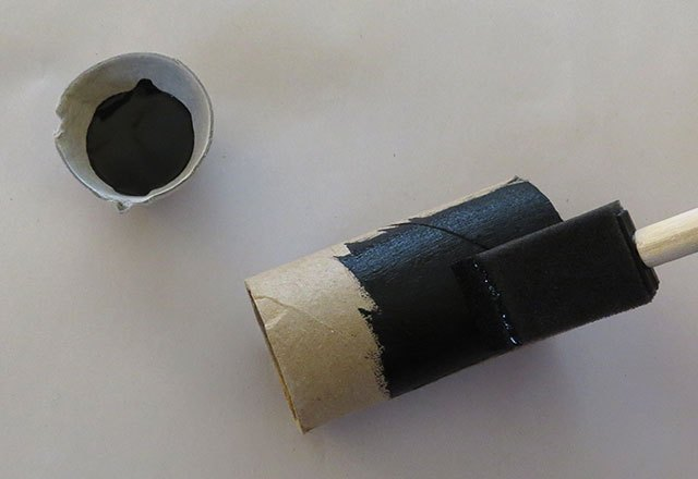 Cut tube and paint black.