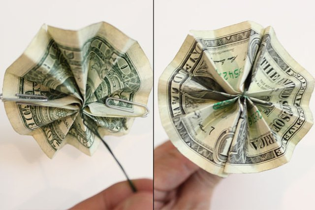 The paper clips are hidden on the bottom of the pinwheel.
