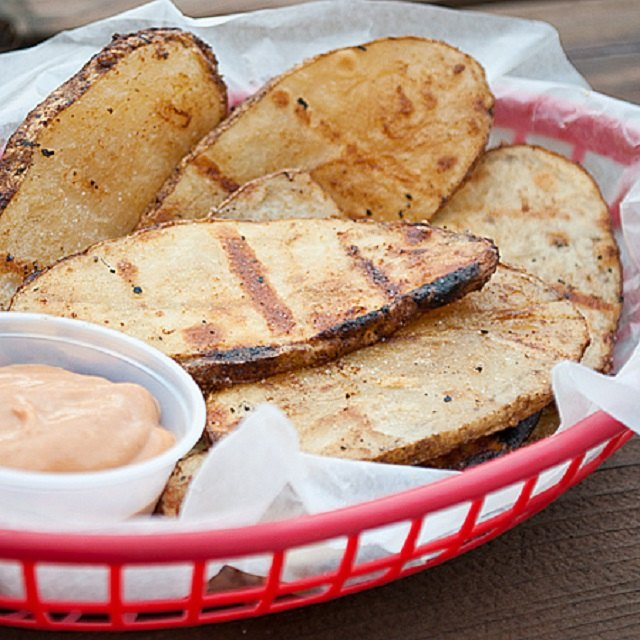 Grilled potatoes with barbecue dipping sauce.