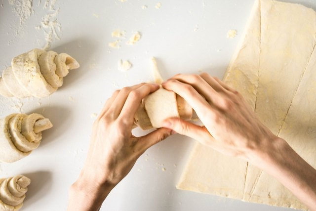 Roll the base toward the point of the dough triangle.