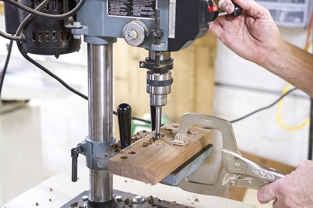 Drill out the concentric and overlapping holes for the phone slot with a drill press.