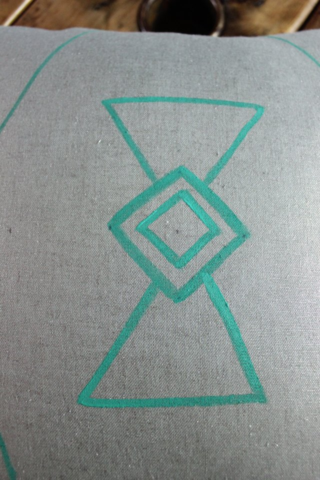 Form a triangle above and below the center diamond.