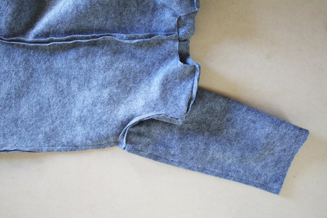 Sew the side seam along the body and sleeve.