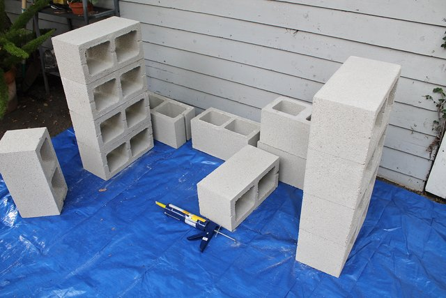 Build two cinder block supports.