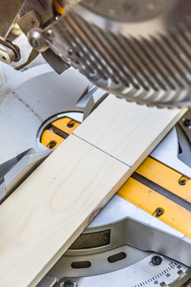 Use a miter saw to evenly cut the vertical planks to the desired height