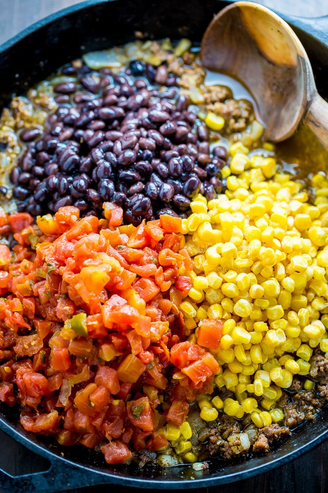 Add the corn, black beans, tomatoes, and chicken stock.