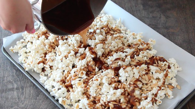 Pour caramel over popcorn mix and stir.
