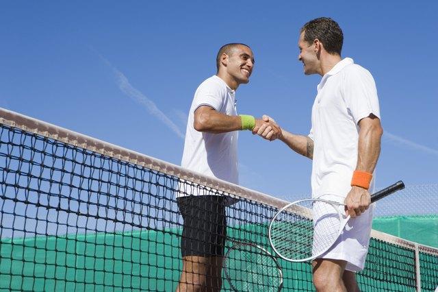 Men shaking hands after tennis