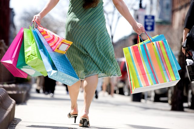 Cropped shot of woman with shopping bags