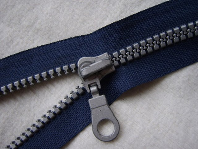 How to fix a zipper that is stuck in fabric ehow a zipper is bound to malfunction at some point ccuart Gallery