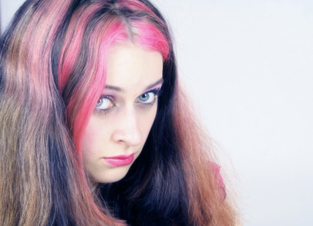 Colored hairspray temporarily changes your hair color for Halloween or other occasions.