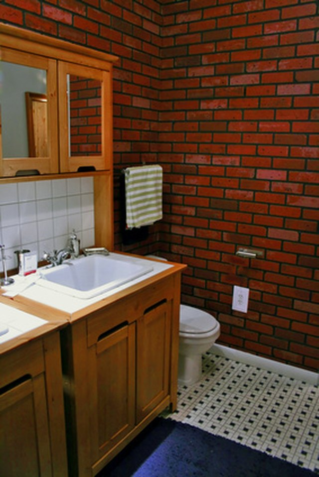 Antiquing plain cabinets gives them a new look. - How To Antique Bathroom Cabinets EHow