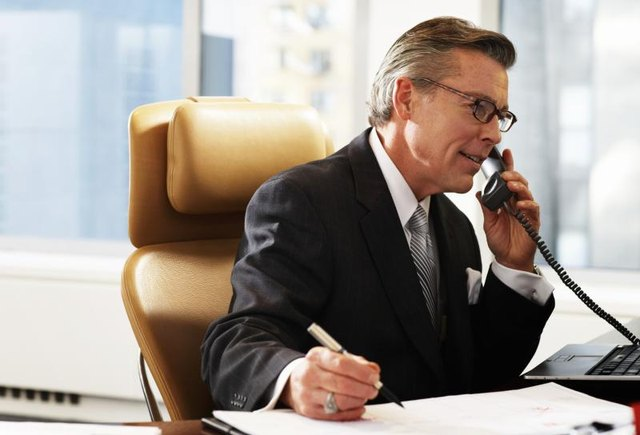 A businessman is on the phone.
