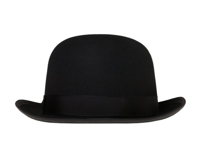 97f08d8fdb1859 The bowler hat has an upturned brim and a ribbon.
