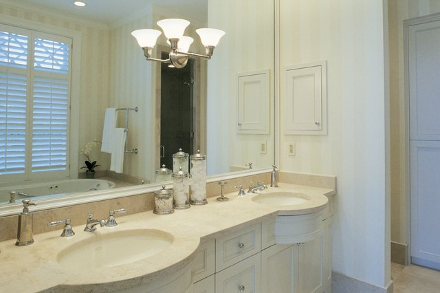 Installing a new light fixture can increase the amount of light in your bathroom.