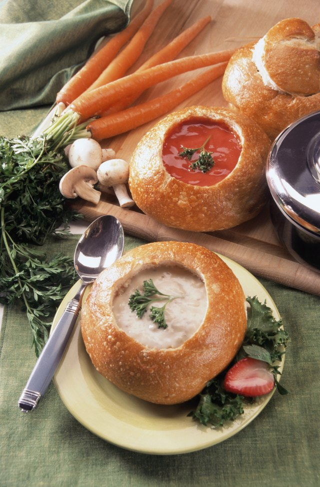 Hollow out the center of bread to create a bowl for dips or soups.