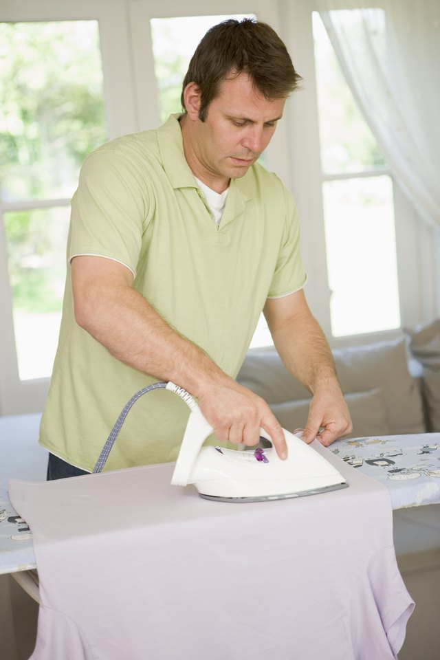 Man using dry iron