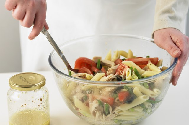 Pasta Salad With Vegetables Tossed In A Warm Rich Dressing Sits Well On Plate