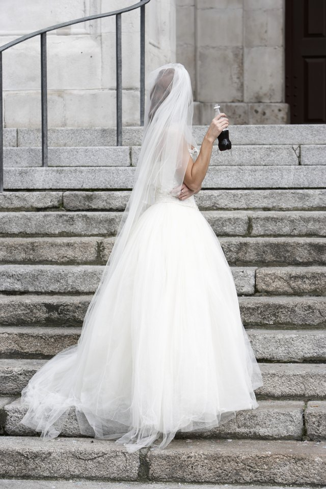 Tulle is often used under wedding dresses to help them poof outward.