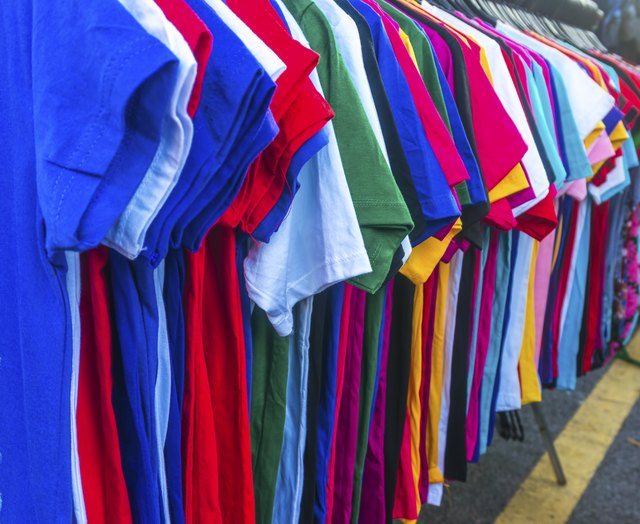 T-shirts hanging on rack.