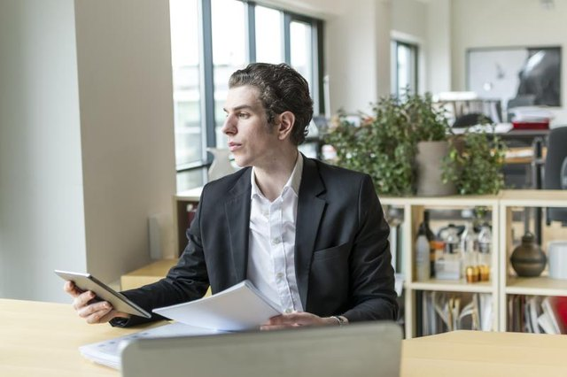 A young businessman is at his desk.