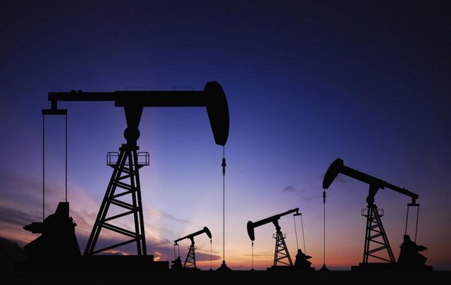 Oil pumps are operating in a field.