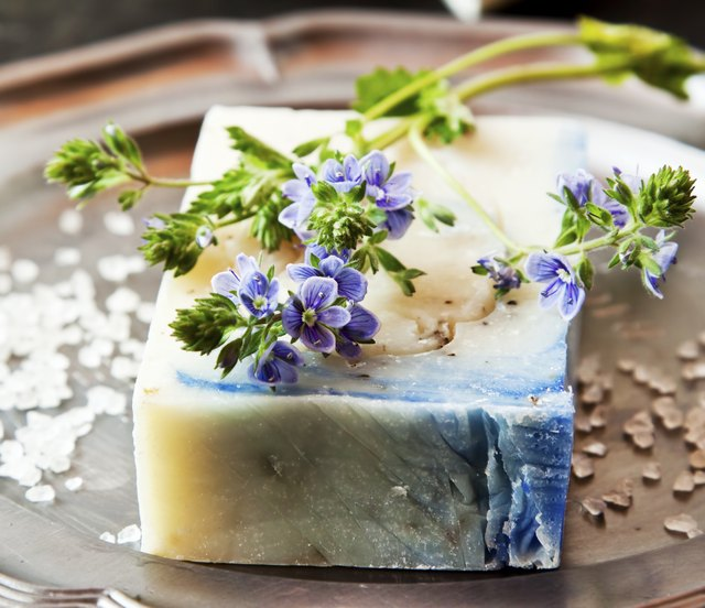 You can add dried lavender or rose petals to homemade soap.