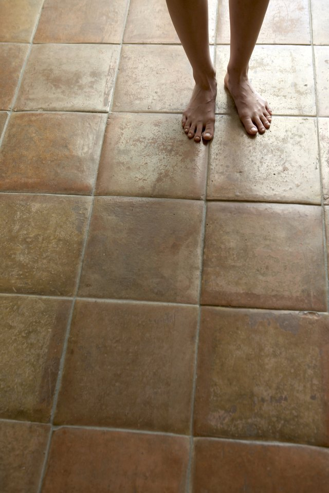 why are the porcelain floor tiles popping ehow