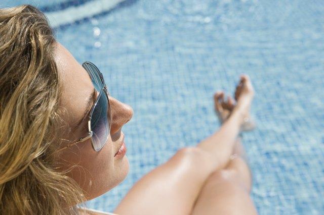 Teenage Girl Sitting By Pool