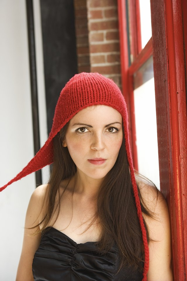 f9ba8c4131a Making a hat with ear flaps is easy on a knitting loom.