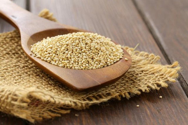Natural organic cereal quinoa on a wooden table