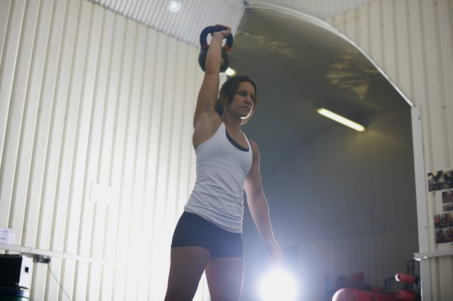 Crossfitter lifting kettlebell in gym
