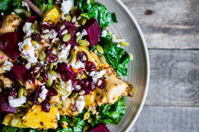 Healthy salad with grilled chicken,kale.beets and goat cheese