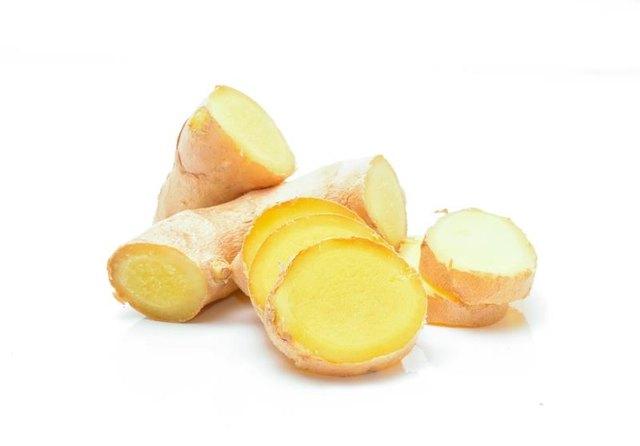Fresh ginger on white background in studio