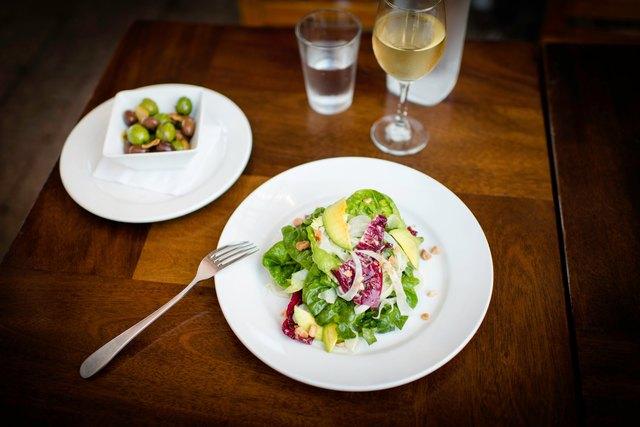Plate of avocado salad on restaurant table