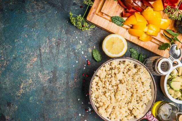 Cooked Quinoa with chopped vegetarian ingredients, top view