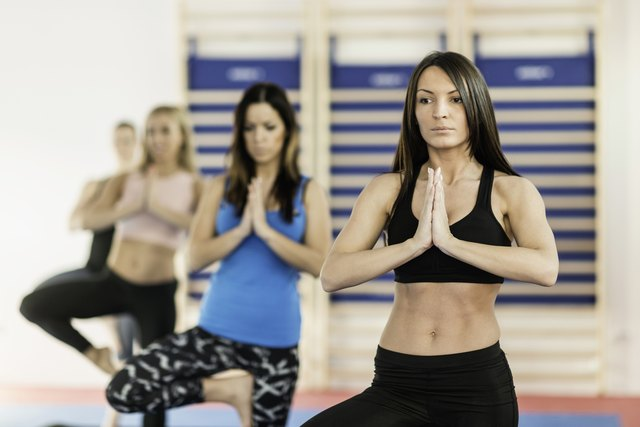 Yoga class: Women in tree pose