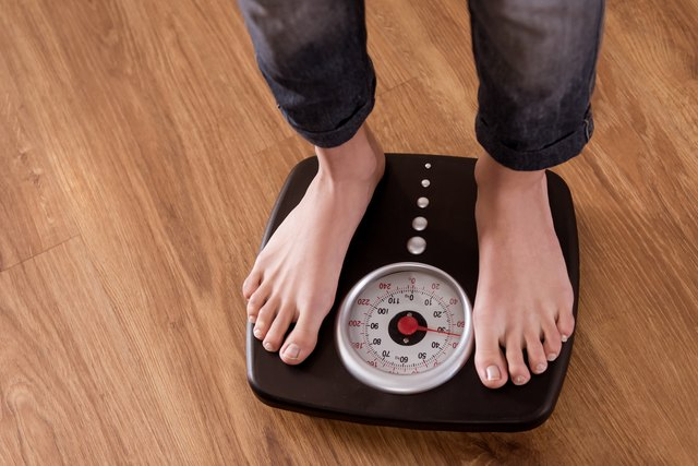 Girl standing on weight