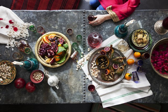 Overhead of woman sitting at Moroccan themed table