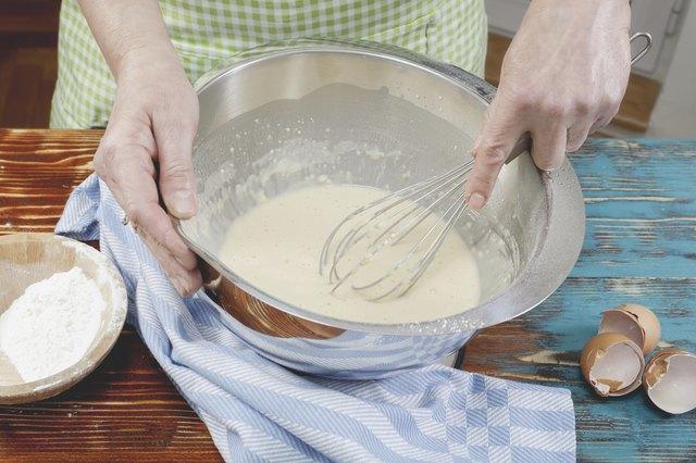Woman making pancake batter
