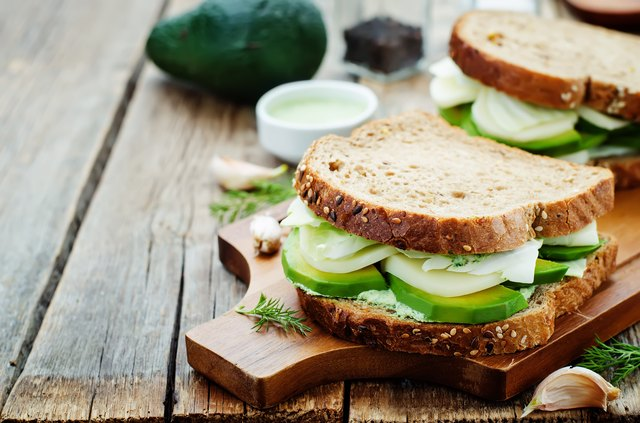 sandwiches with avocado, cheese, cabbage and cheese and herb topping