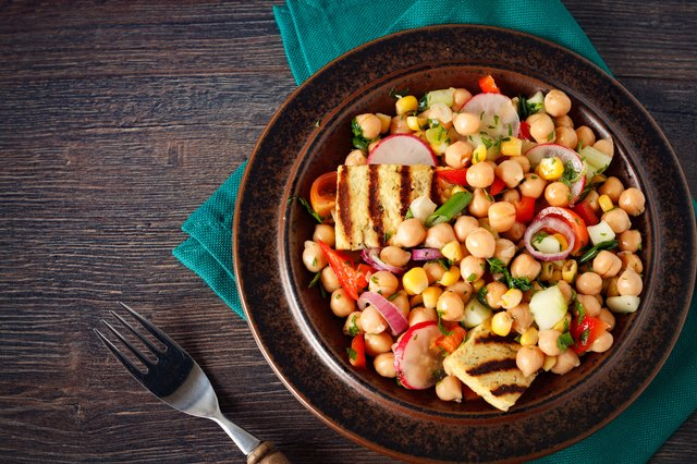 A plate of homemade chickpea salad with tofu