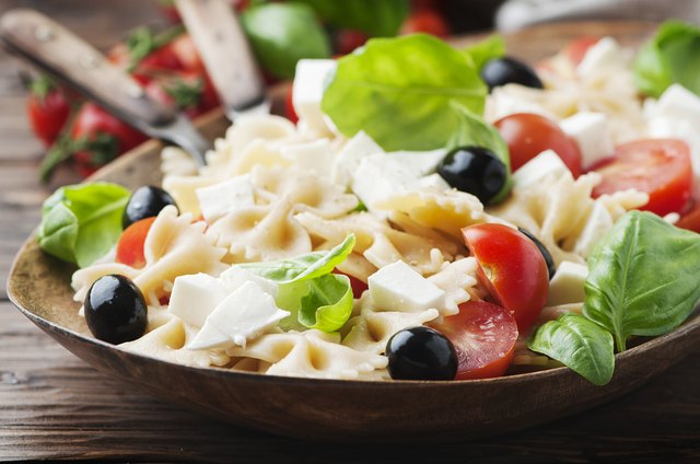 Salad with cold pasta and mozzarella