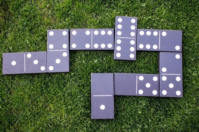 Giant black dominoes on grass