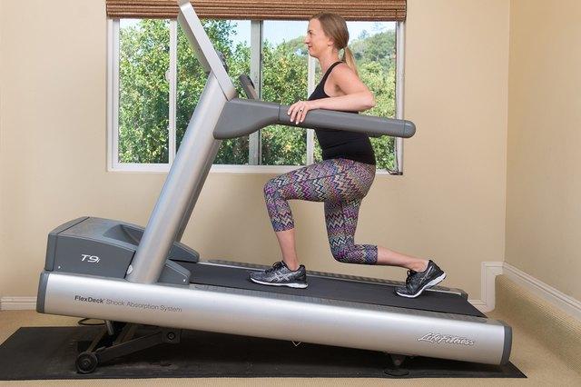 Mature woman running on a treadmill