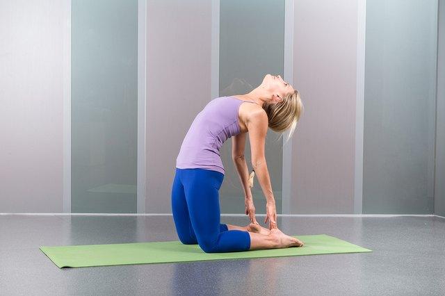 woman exercising Ustrasana camel pose yoga silhouette