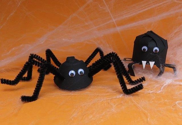 Repurpose empty egg cartons into DIY fake spiders.